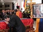 Iranian Leader Mahmoud Ahmadinejad kisses Hugo Chavez's coffin